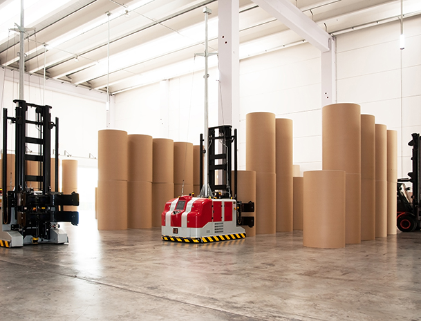 Automated forklift picking up rolls of paper