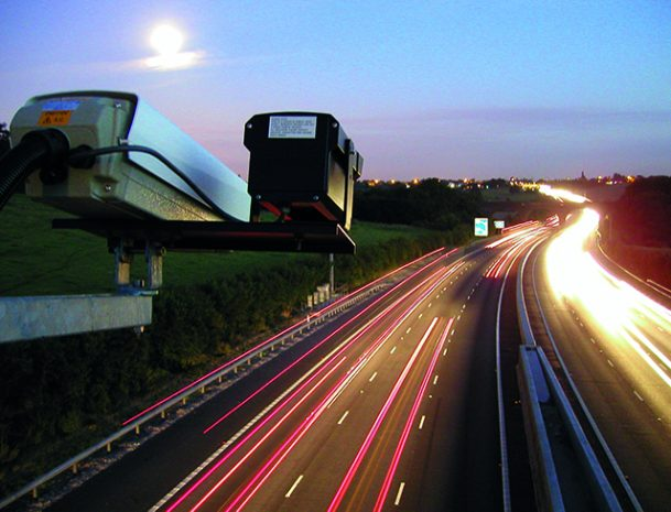 Road camera pointing down on busy motorway