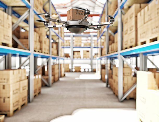 Drone carrying package through warehouse